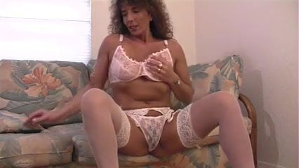 Sexy tan mature in stockings solo