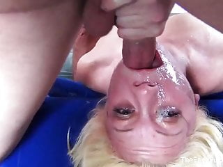 Cute blonde chick gets her face wrecked by two cocks