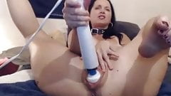Huge toys in her pussy as she plays