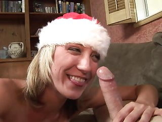 Young blonde gives lucky dude a christmas fuck