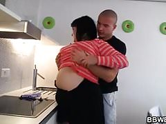 Horny guy fucks busty plumper at the kitchen