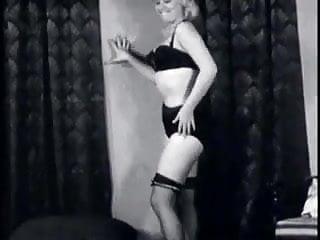 Vintage Blond women in a black bra