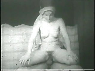 Old-timey arab sheikh licks and strokes harem girl's pussy, then she blows him