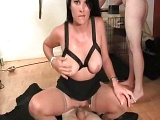 Very attractive Mistress uses two slaves