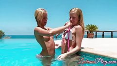 Beautiful young lesbians pleasing pussies at an outdoor pool