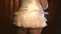 Chubby girl stripping in a white dress
