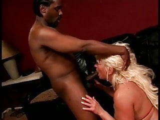 Blonde white mature woman loves to suck on a huge black interracial cock