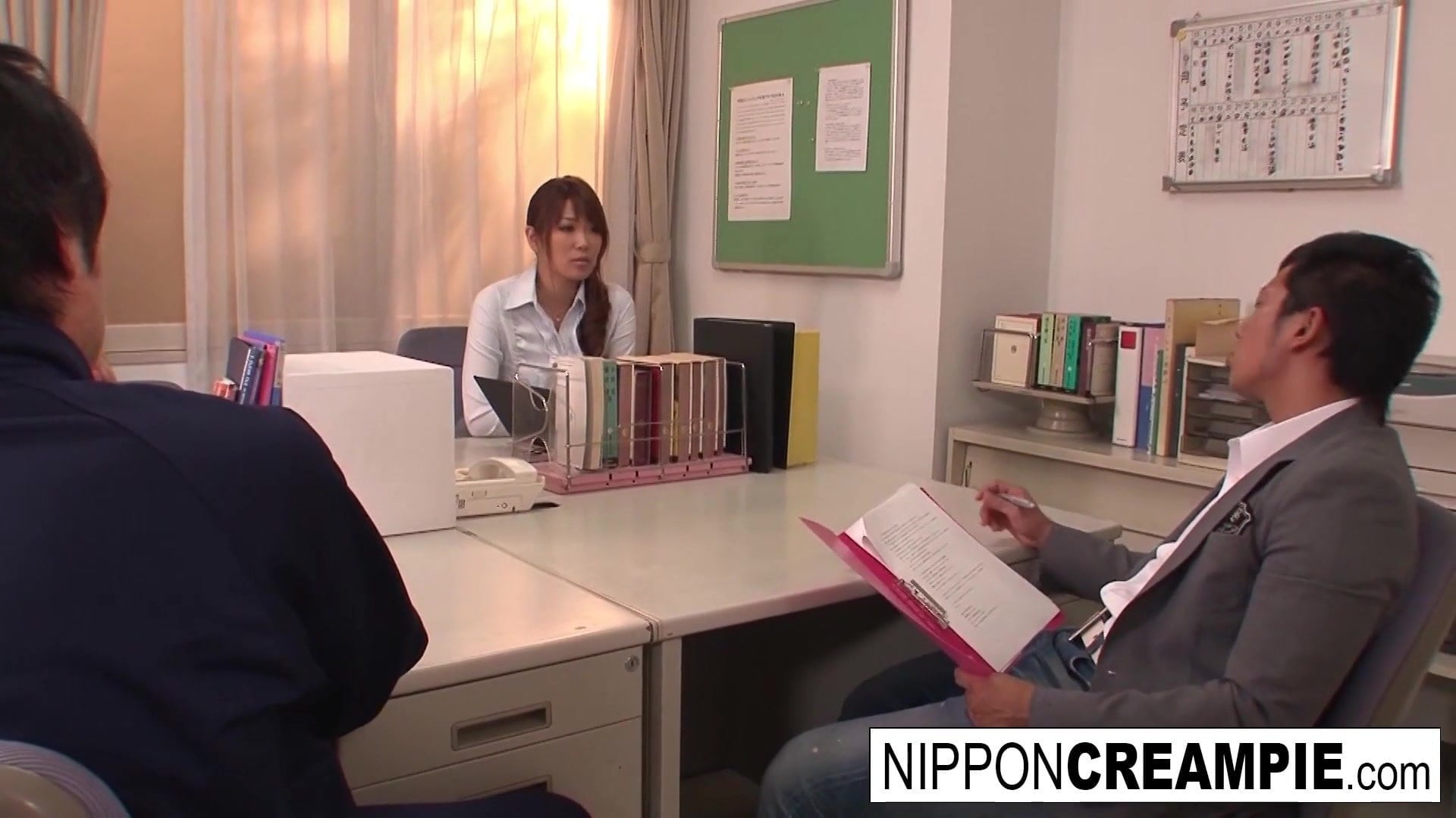 Japanese babe has a threesome within the instructor's lounge