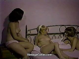 Two women having sex in the cowgirl position