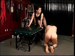 Mistress steps on his genitals with heels