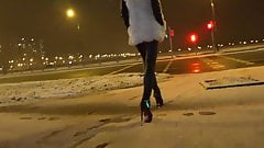 Girl walking in hot leather leggins and high heels outdoor