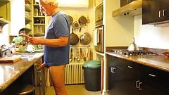 In the kitchen with an erection