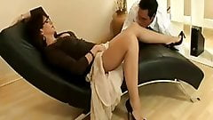 Sexy mature slut in nylons and heels teases a young stud
