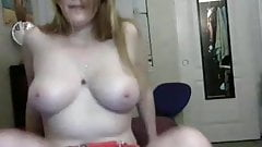 Cutie playing with her boobs