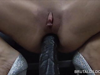 Big dildos in both her holes