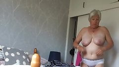 Busty mature caught changing again.