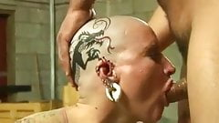 Tattoed pierced bald head slut