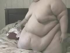 ssbbw strips on bed