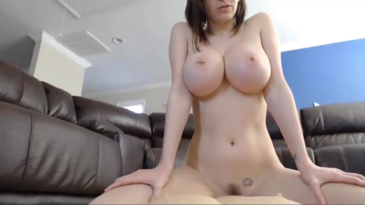 busty brunette with fake boobs rides dildo