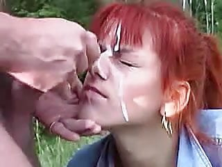 Outdoor gooey facial on red haired cock sucker