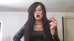 Gorgeous Tranny with long red nails smokes