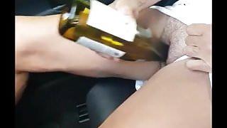 Wife cums in car frigging bottle