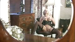 Blonde massages herself in front of mirror