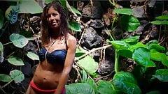 Hot busty milf in bikini stripping outdoors