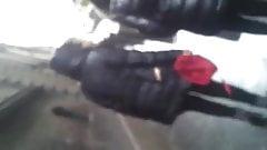 Shiny black downjacket walk street