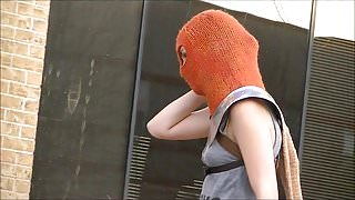 Masked woman does performance art downtown