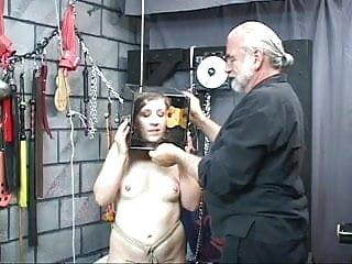 Captured brunette has her head stuffed in a box.