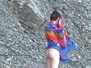 Woman pisses under the waterfall shower