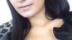Hot brunette looking sexy on webcam