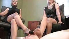 One guy worship the nylon feet of two secretarys porn image