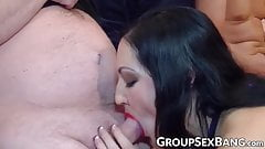 Curvaceous vixen riding one and sucking the other cock