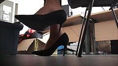 secretary in black high heels and tan nylon socks