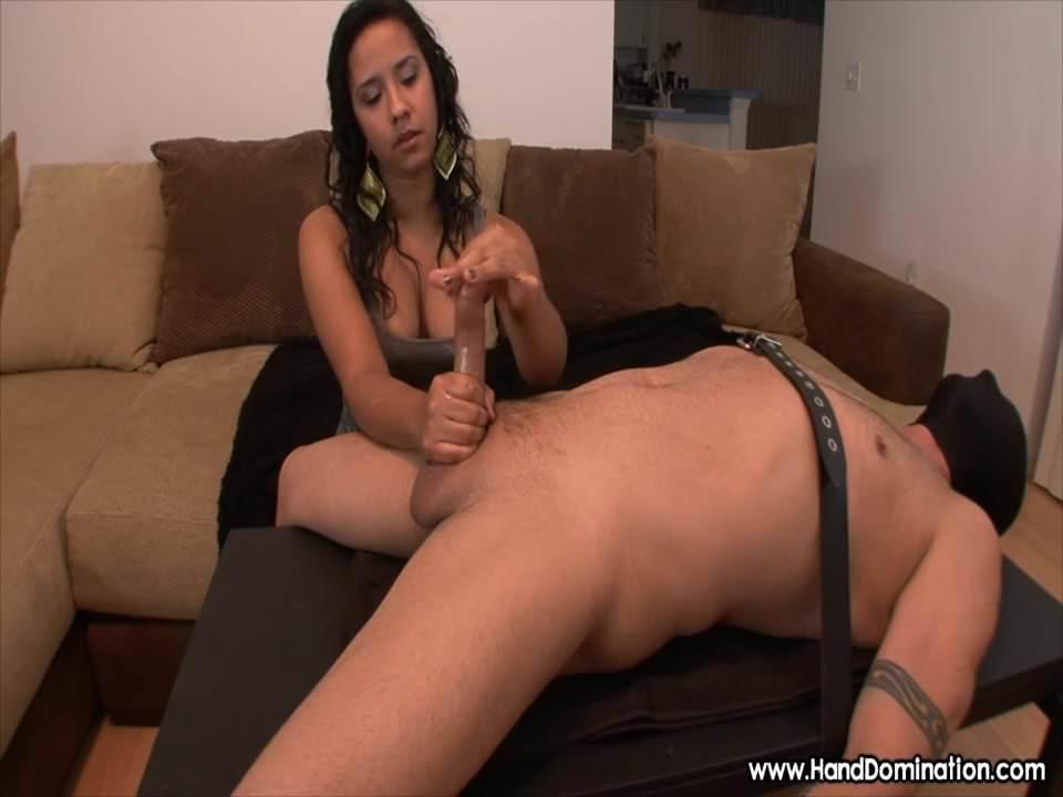 Spanish girl evaluates cock during femdom handjob 2