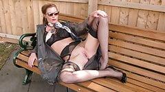 Kinky Milf wanks openly on bench in  nylons garters heels