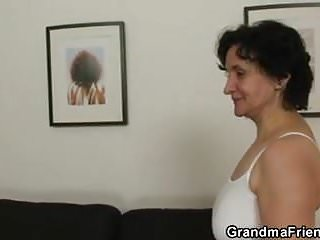 Granny takes two cocks from both sides