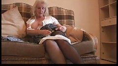 Solo european granny fingering her pussy