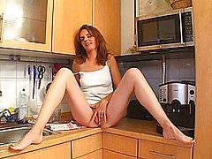 Slutty redhead amateur Milf gets fucked in her kitchen