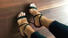 Beautiful strappy sandals in black on beautiful feet.