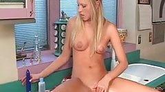 Little Blond Slut masturbating on the kitchen counter