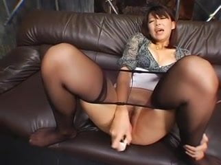 Japanese lady masterbates through panty hose.
