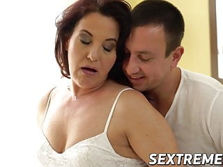 Curvy redhead granny takes throbbing young cock balls deep