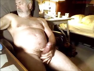 Old bearded guy shooting a load during phone sex