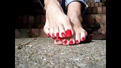 Long red toenails