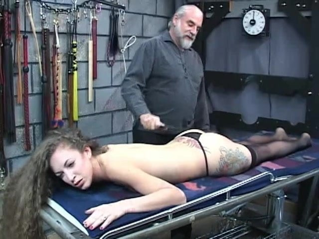 Submissive slut gets body bound with rope and pulled by dom