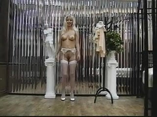 Sexy blonde in stockings shows off her pussy and ass for the camera