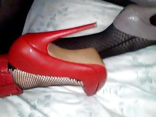 Girl in fishnets and red heels fucked by crossdresser